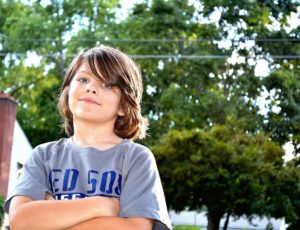 young boy in gray t-shirt